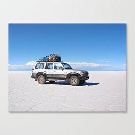 4wd car on the Salar de Uyuni salt flats Canvas Print