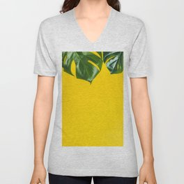 Tropical leaves on yellow background, space for text Unisex V-Neck