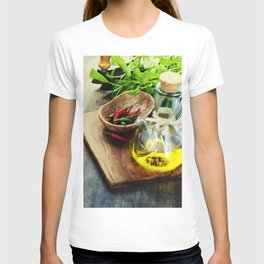 fresh  herbs, olive oil and vegetables on cutting board T-shirt
