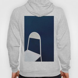 White chair on Blue background Hoody