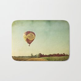 Hot Air Balloon Over Farmland Bath Mat