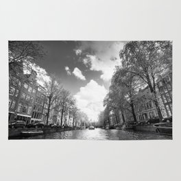 View from a boat in Amsterdam canal Rug