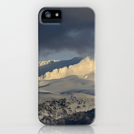 Snowy mountains through the clouds. iPhone Case