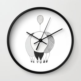 Women chatting and cuddling a baby Wall Clock