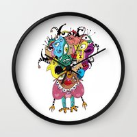 talking heads Wall Clocks featuring Heads by R. Gorkem Gul