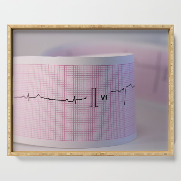 Approach and defocus an electrocardiogram strip. Record of the electrical activity of the heart. Serving Tray