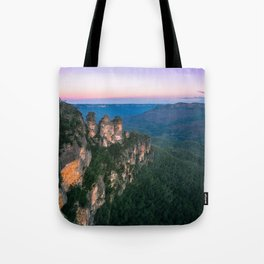 Cold morning but warm sunrise colors in the sky at Three Sisters in Blue Mountains. Tote Bag