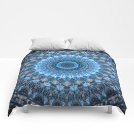Digital mandala with light blue dominant. Comforters