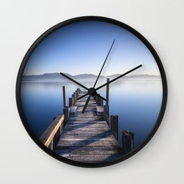 Wooden pier or jetty at sunrise. Long Exposure Tuscany, Italy. Wall Clock