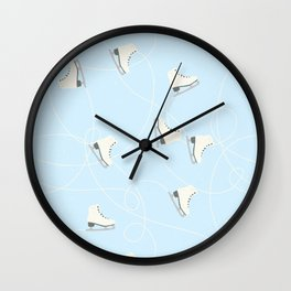 Ice Skating on Ice Blue Background Wall Clock