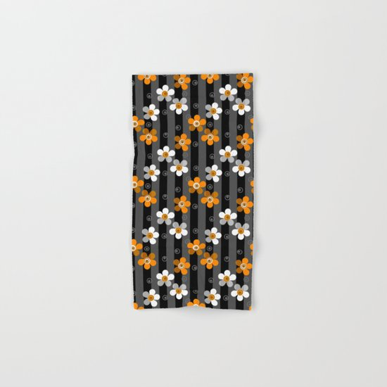 Black and yellow floral pattern on a striped background . Hand & Bath Towel