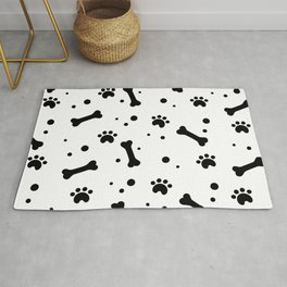 Dog's paw print and bone seamless pattern Rug