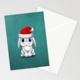 White Floppy Eared Baby Bunny Wearing a Santa Hat Stationery Cards