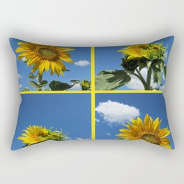 big sunflower shines yellow against a blue sky with white clouds Rectangular Pillow