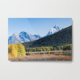 Snow capped mountain and autumn trees Metal Print