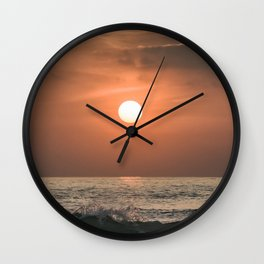 Red sunset in the ocean Wall Clock