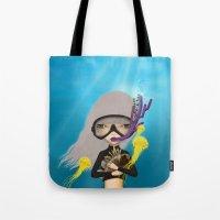scuba Tote Bags featuring scuba by Anne  Martwijit