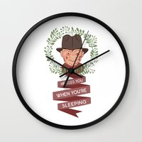 freddy krueger Wall Clocks featuring Freddy Krueger Christmas by Big Purple Glasses