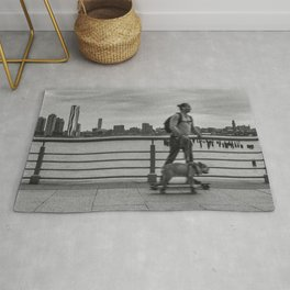 Young Man & his Dog Riding Skateboards, A Rug