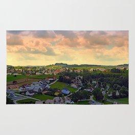 Beautiful village skyline beyond cloudy sky   landscape photography Rug
