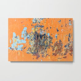 Orange metal background with cracked, peeling paint with stains of blue paint and rust spots. Metal Print