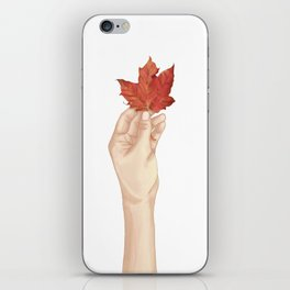 Holding the autumn iPhone Skin