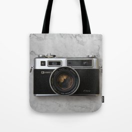 Yashica electro 35 on white marble Tote Bag