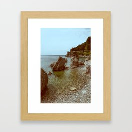 A coastline and a castle Framed Art Print