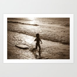 Little surfer girl runs in the waves with her bodyboard Art Print