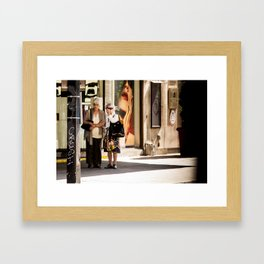 Elderly Onlookers Framed Art Print