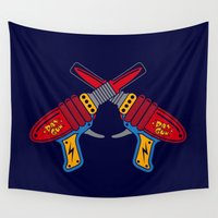 guns Wall Tapestries featuring Crossed Retro Ray Guns by René Martin