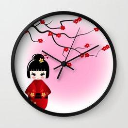 Japanese kokeshi doll at sakura blossoms Wall Clock