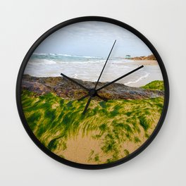 Seashore Rock with Moss and Lifeguard Tower in The Background Wall Clock