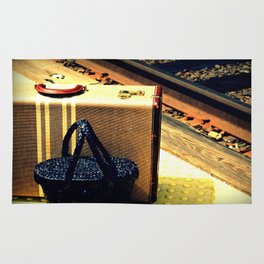 A Vintage Suitcase and A Straw bag Rug