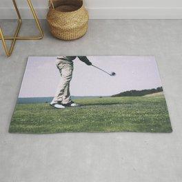 Golfer at a golfcourse Rug