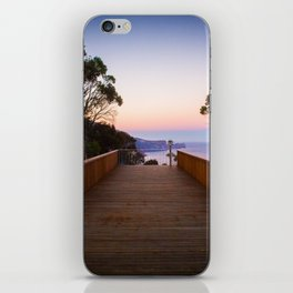 Sitting on the dock of the cliff iPhone Skin