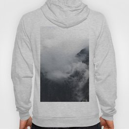 White clouds over the dark rocky mountains Hoody
