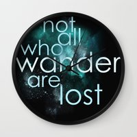 not all who wander are lost Wall Clocks featuring not all who wander by Gabrielle Agius