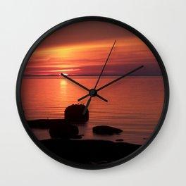 Peaceful Reflections of Nature at Dusk Wall Clock