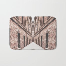 walkway in the middle of the brown brick buildings Bath Mat