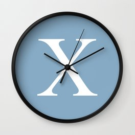 Letter X sign on placid blue background Wall Clock