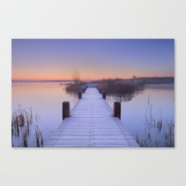 Boardwalk on a lake at dawn in winter, The Netherlands Canvas Print