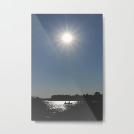 Silhouettes of two people on a rubber boat in a sunny reflection Metal Print