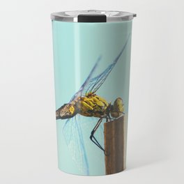 Beautiful colorful dragonfly insect close-up resting on dried bamboo stick in summer Travel Mug