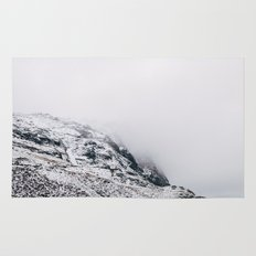 Fleetwith Pike in cloud and snow. Honister Pass, Cumbria, UK. Rug