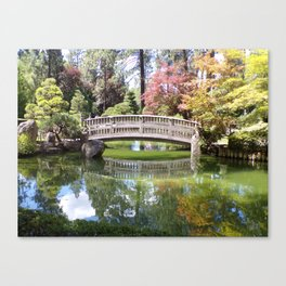 Small Wood Bridge Over Pond In Japanese Garden Canvas Print
