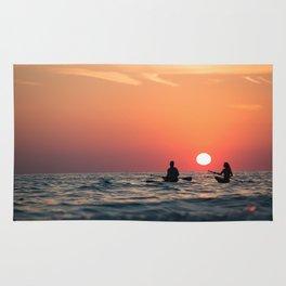man woman boat rowing in sea Rug