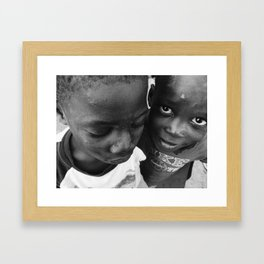 Boys at the river Framed Art Print