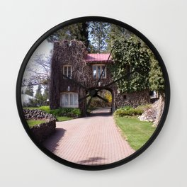 Beautiful Rock Building With Stone Path Through It Surrounded by Green Wall Clock