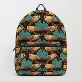 Brown Moths On Teal Backpack